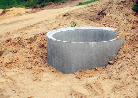Open sewer well in sandy soil during repair or laying of underground utilities in rural areas