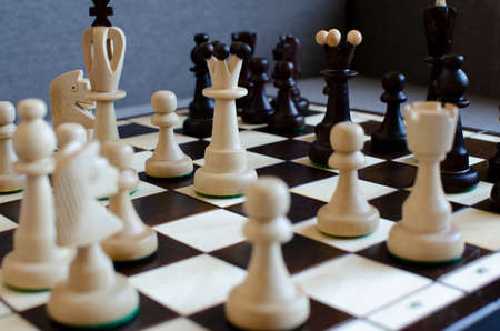 Wooden brown-bodied chess close-up on a chessboard 写真素材