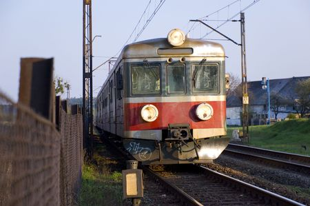 train on rails close to the railway station in Poland photo