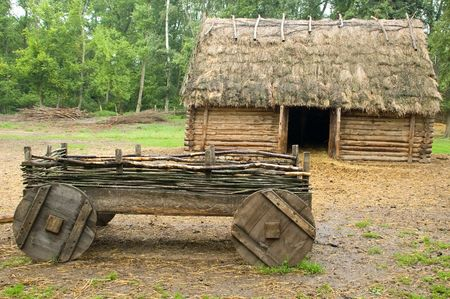 thatch: historic  hut covered by thatch in Biskupin Stock Photo