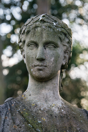 grecian: A Roman Grecian bust in the grounds of a country house Stock Photo