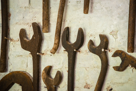 toolset: Rusty spanners on a wall Stock Photo