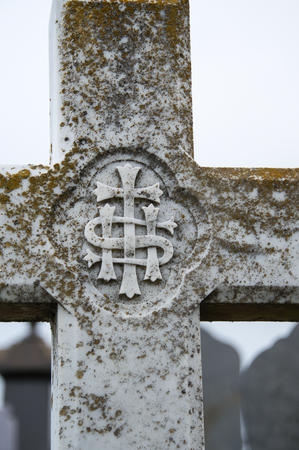 churchyard: A close up of a cross in a churchyard in Angelsey, Wales, UK Stock Photo