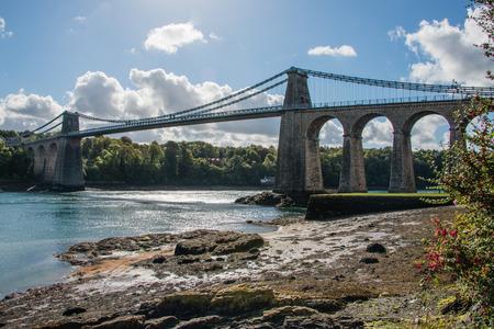 A view of the historic Menai suspension bridge spanning the Menai Straits, Gwynnedd, Wales, UK.