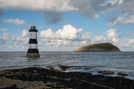 Penmon lighthouse and Puffin Island in Anglesey, Wales, UK