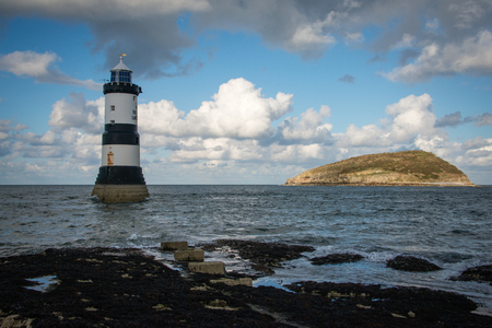 Penmon Lighthouse and Puffin Island at Penmon Point, Anglesey, North Wales
