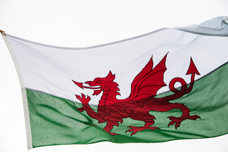 welsh flag: The Welsh flag against a cloudy sky
