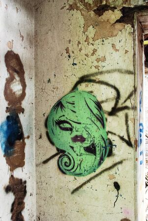 abandoned house: Green graffiti in an abandoned house in Wales, UK Stock Photo