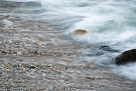 pebbles: Long exposure of waves on a beach in Gansbaai, South Africa