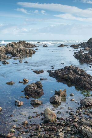 Tranquil tidal pool on a rocky beach in south Africa