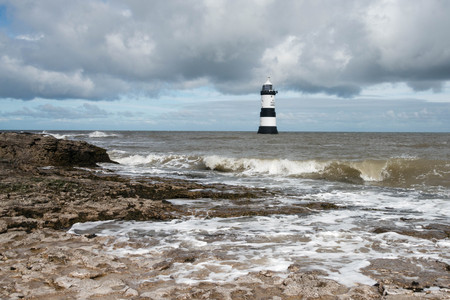 Penmon lighthouse on a stormy day, Anglesey, Wales, UK