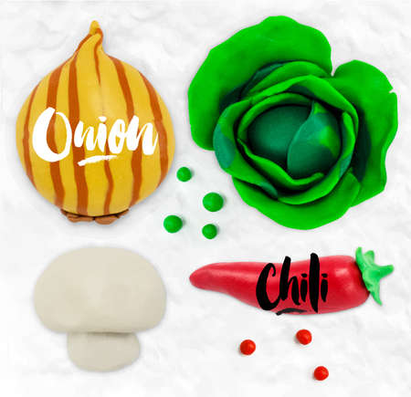 cobbled: Plasticine modeling vegetables onion chilli mushroom cabbage cobbled together on a white plasticine background