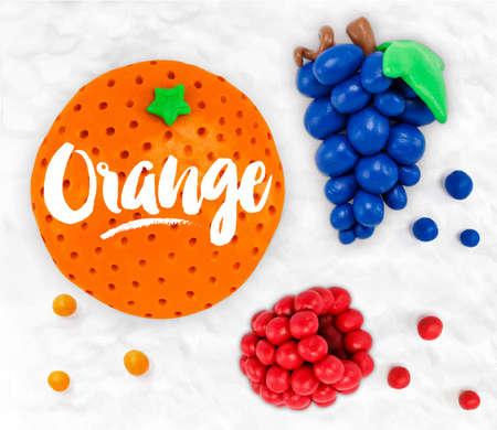 Plasticine modeling fruits orange grapes raspberries cobbled together on a white plasticine background Illustration