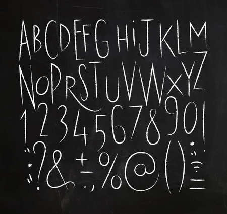 Alphabet set sharp lines font in vintage style drawing with white lines on chalkboard background