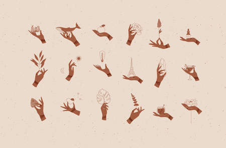 Hands labels with bracelets, rings holding decorative symbols in minimalist style drawing on beige background 스톡 콘텐츠 - 149885384