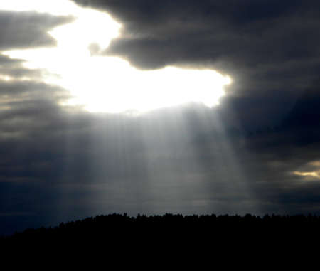 the sky opens up and the sun shining through Stock Photo