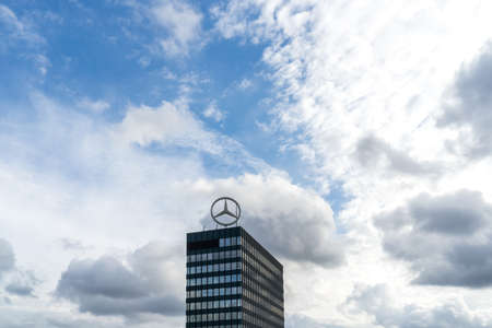 Berlin, Germany - September 30, 2018: View on the top of the Europa-Center commercial building with a huge Mercedes-Benz logo spinning on the very top of it Editorial