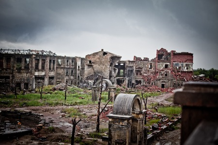 devastation: abandoned houses and ruined city wet and muddy