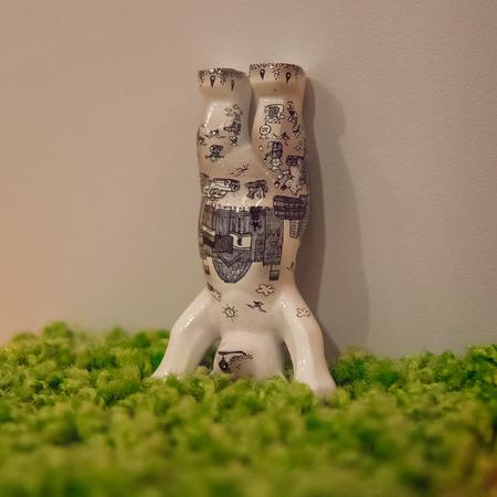 porcelain bear standing upside down