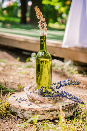 Composition of flowers, spikelets, and wood in nature. Accessories and decor handmade in rustic style