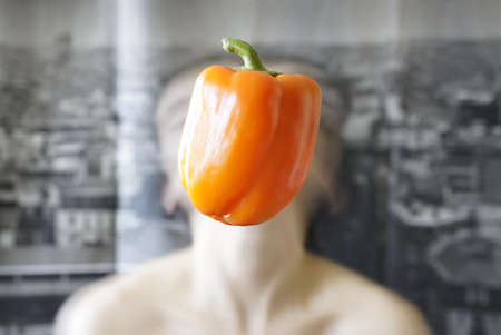 a pepper replace the motion blurred face of a girl
