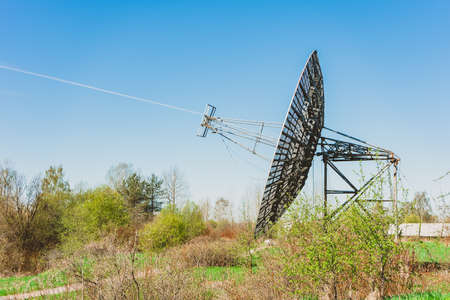 A large radio antenna in the form of a dish stands in the field. Astronomical Observatory of the Academy of Sciences.
