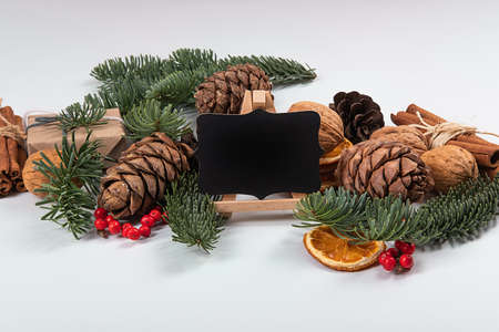 Beautiful New Year composition with wooden blackboard for texting by chalk.