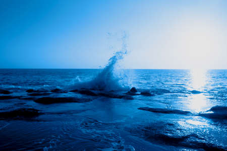 Beautiful seascape with the sunset in the trendy classic blue color of the year. Фото со стока