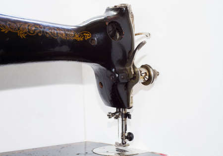 old antique sewing machine close-up in parts in the photo