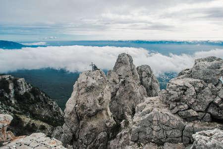 Mountain in the clouds with a crucifix around Ai-Petri in Crimea Stock Photo