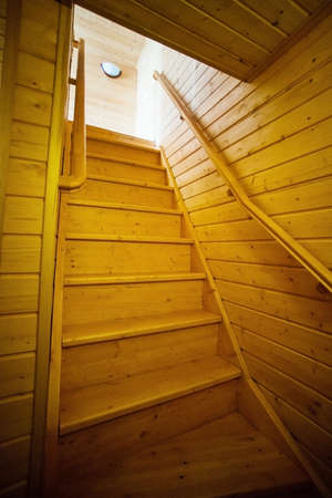 second floor: Wooden staircase to the second floor of a wooden house