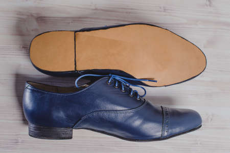 Stylish blue mans crafted shoes for ballroom dancing with laces from skin and suede. crafted mens blue boots for ballroom dancing made of genuine leather. in side view Stock Photo