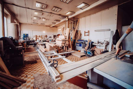 View of the production hall of carpentry. Toned image. View of woodworking shop.
