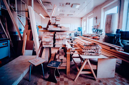 View of the production hall of carpentry. Toned image. View of woodworking shop. from another angle