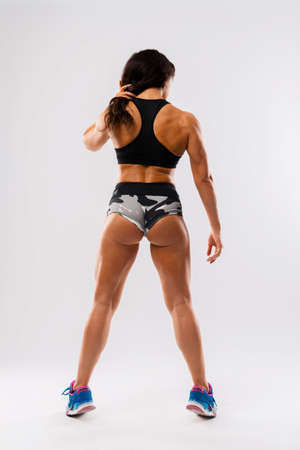 Female Model with Fit Muscular and Slim Body Posing in Sportswear