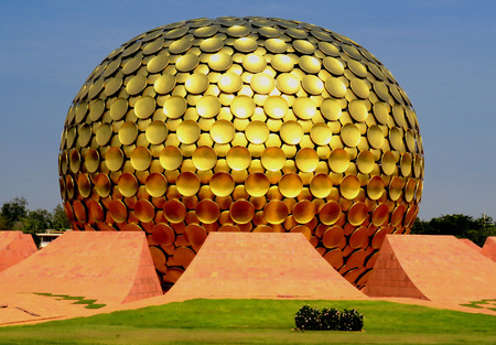 Matrimandir Temple in the form of a huge golden ball closely. Auroville, India.