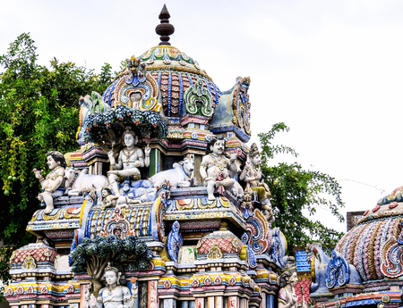 Statues of Lord Shiva and other mythological creatures on one of the Gopuram ancient Shiva temple of the 18th century, Pondicherry, South India