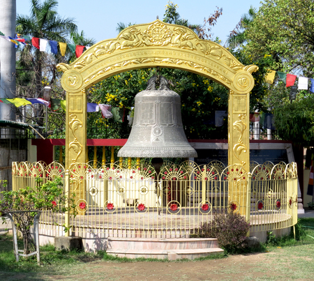 Ancient Buddhist bell next to the temple at Sarnath, the place of Buddhas first sermon near Varanasi. India