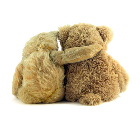 Old ted comforting younger teddy bear.
