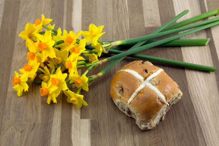 Spring daffodils and easter hot cross bun. photo