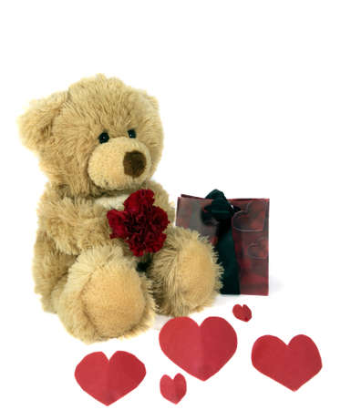 Fluffy teddy with flower and red hearts. photo