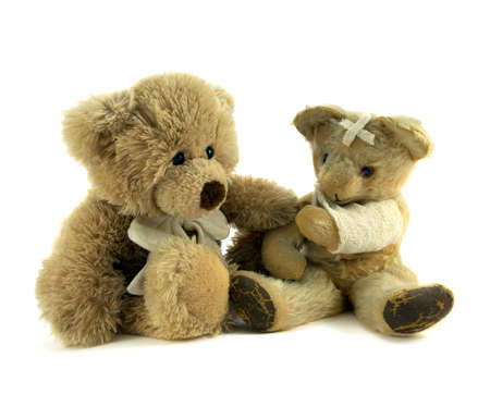 ted: Teddy with arm in sling being comforted. Stock Photo