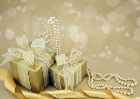 beautifully wrapped: Two beautifully wrapped presents,wine glass and pearls