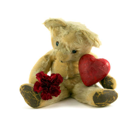 valentine s day teddy bear: Old teddy with carnation and red heart