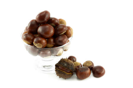 horse chestnuts: Conkers or Horse chestnuts in a clear glass bowl