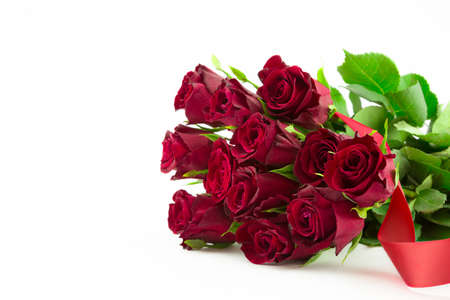 A bouquet of twelve red roses