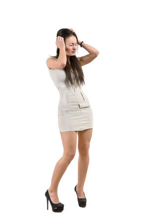 desperately: woman desperately holds on to her head Stock Photo