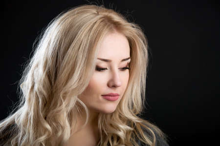 the contour: contour of beautiful blonde with curly hair on black background