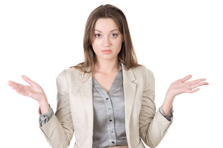 variability: business woman shrugs unsure of the answer, and not knowing the answer