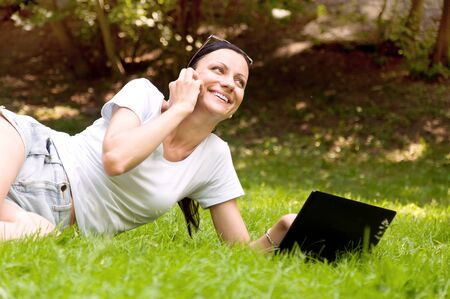 freelancing: girl working freelance. makes chat in the park Stock Photo